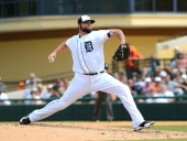 Joba Chamberlain of the Detroit Tigers pitches during the spring training game against the Toronto Blue Jays at Joker Marchant Stadium on March 11...