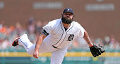 Joba Chamberlain of the Detroit Tigers pitches in the eighth inning of the game against the Colorado Rockies at Comerica Park on August 3 2014 in...