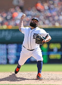 Joba Chamberlain of the Detroit Tigers pitches in the eighth inning of the game against the New York Yankees at Comerica Park on August 28 2014 in...