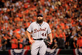Joba Chamberlain of the Detroit Tigers reacts after giving up two runs in the eighth inning against the Baltimore Orioles during Game One of the...