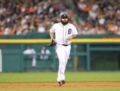 Joba Chamberlain of the Detroit Tigers runs to the mound during the eighth inning of the game against the Oakland Athletics at Comerica Park on June...