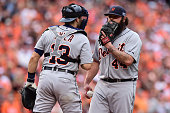 Joba Chamberlain of the Detroit Tigers talks to Alex Avila against the Baltimore Orioles during Game Two of the American League Division Series at...