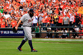 Joba Chamberlain of the Detroit Tigers walks to the dugout after giving up a run in the eighth inning against the Baltimore Orioles during Game Two...
