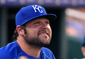 Joba Chamberlain of the Kansas City Royals watches from the dugout in the first inning against the Minnesota Twins at Kauffman Stadium on September 7...