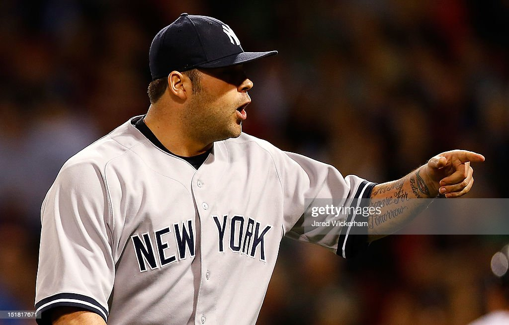 Joba Chamberlain #62 of the New York Yankees celebrates after getting out of a bases-loaded jam against the Boston Red Sox during the game on September 11, 2012 at Fenway Park in Boston, Massachusetts.