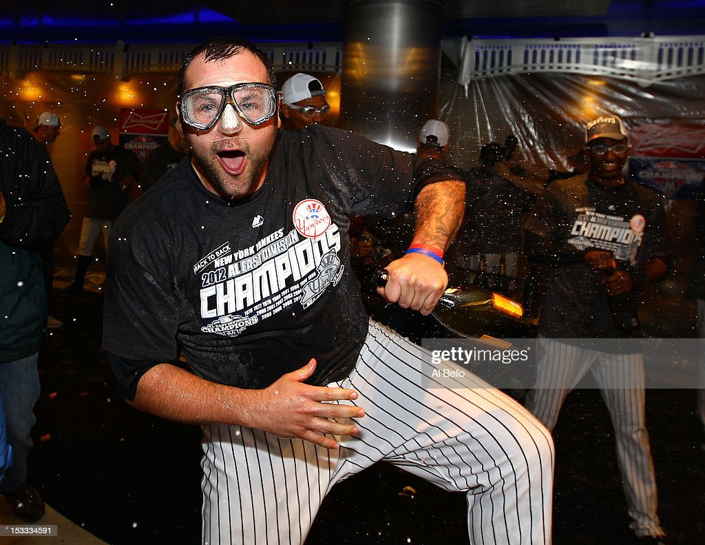 <a gi-track='captionPersonalityLinkClicked' href=/galleries/search?phrase=Joba+Chamberlain&family=editorial&specificpeople=4391682 ng-click='$event.stopPropagation()'>Joba Chamberlain</a> #62 of the New York Yankees celebrates winning the American League East Division Championship after their 14-2 win against the Boston Red Sox on October 3, 2012 at Yankee Stadium in the Bronx borough of New York City.