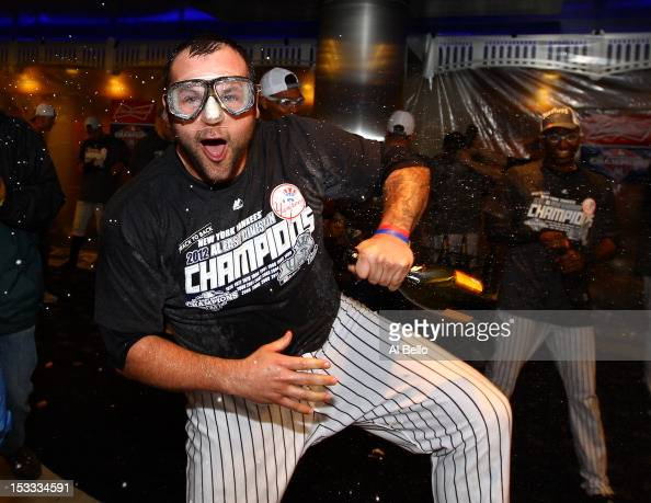 Joba Chamberlain of the New York Yankees celebrates winning the American League East Division Championship after their 142 win against the Boston Red...