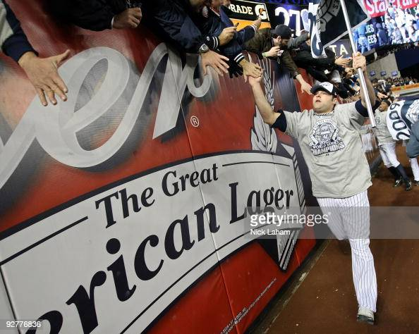 Joba Chamberlain of the New York Yankees celebrates with fans after their 73 win against the Philadelphia Phillies in Game Six of the 2009 MLB World...