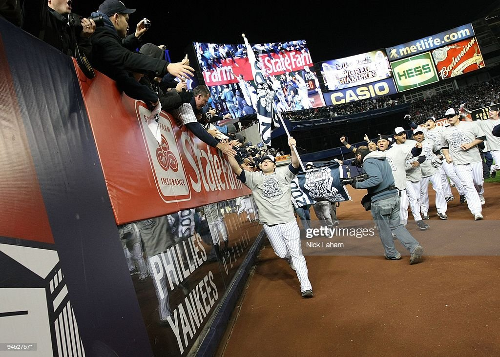 <a gi-track='captionPersonalityLinkClicked' href=/galleries/search?phrase=Joba+Chamberlain&family=editorial&specificpeople=4391682 ng-click='$event.stopPropagation()'>Joba Chamberlain</a> of the New York Yankees celebrates with fans after their 7-3 win against the Philadelphia Phillies in Game Six of the 2009 MLB World Series at Yankee Stadium on November 4, 2009 in the Bronx borough of New York City.