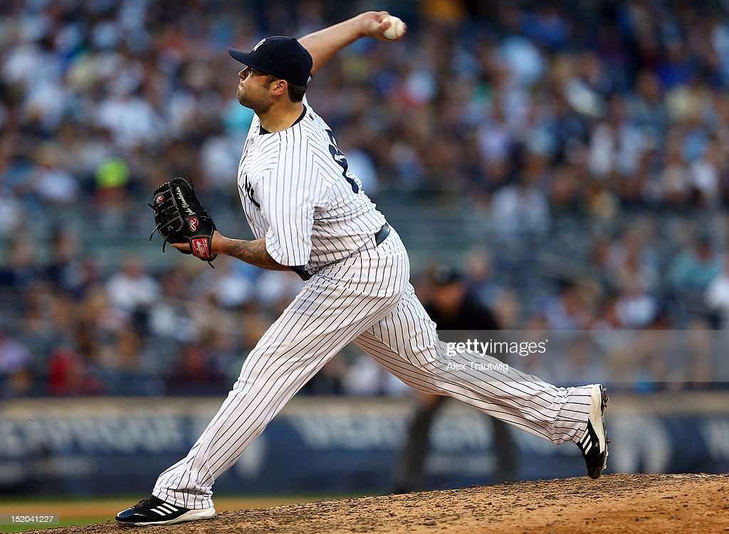 Joba Chamberlain #62 of the New York Yankees delivers a pitch in the seventh inning against the Tampa Bay Rays on September 15, 2012 at Yankee Stadium in the Bronx borough of New York City.