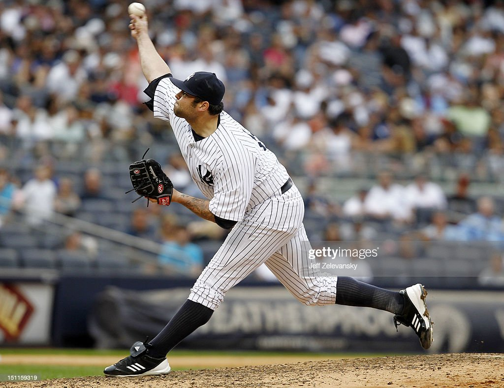 <a gi-track='captionPersonalityLinkClicked' href=/galleries/search?phrase=Joba+Chamberlain&family=editorial&specificpeople=4391682 ng-click='$event.stopPropagation()'>Joba Chamberlain</a> #62 of the New York Yankees delivers against the Baltimore Orioles at Yankee Stadium on September 2, 2012 in the Bronx borough of New York City.
