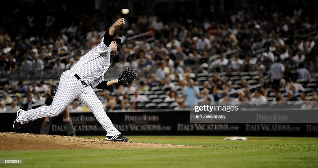 Joba Chamberlain of the New York Yankees delivers in the first inning of a game against the Los Angeles Angels of Anaheim at Yankee Stadium on...