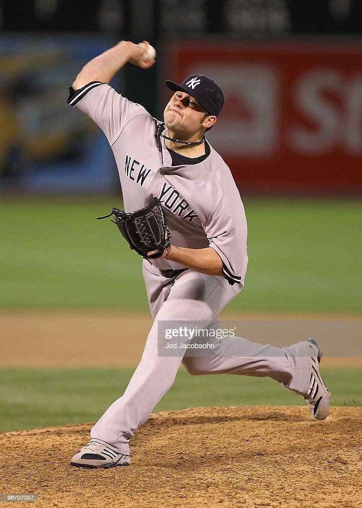 Joba Chamberlain of the New York Yankees in action against the Oakland Athletics during an MLB game at the OaklandAlameda County Coliseum on April 20...