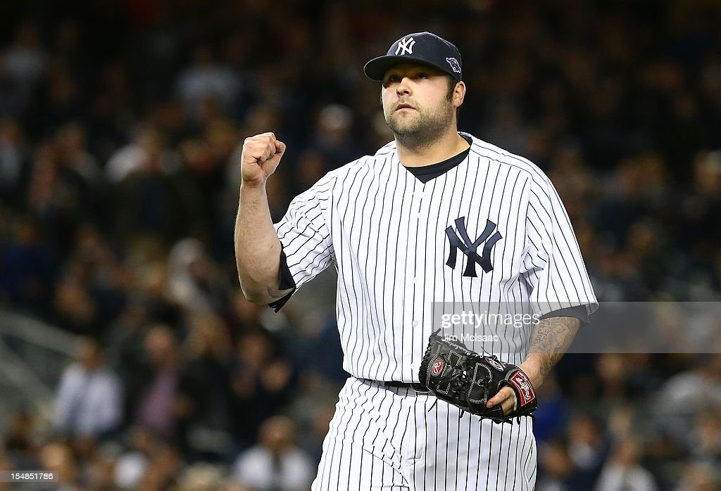 Joba Chamberlain #62 of the New York Yankees in action against the Baltimore Orioles during Game Four of the American League Division Series at Yankee Stadium on October 11, 2012 in the Bronx borough of New York City. The Orioles defeated the Yankees 2-1 in 13 innings.