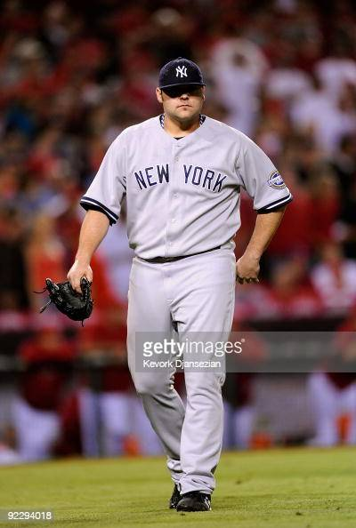 Joba Chamberlain of the New York Yankees leaves the mound after being relieved by teammate Mariano Rivera during the eighth inning in Game Five of...