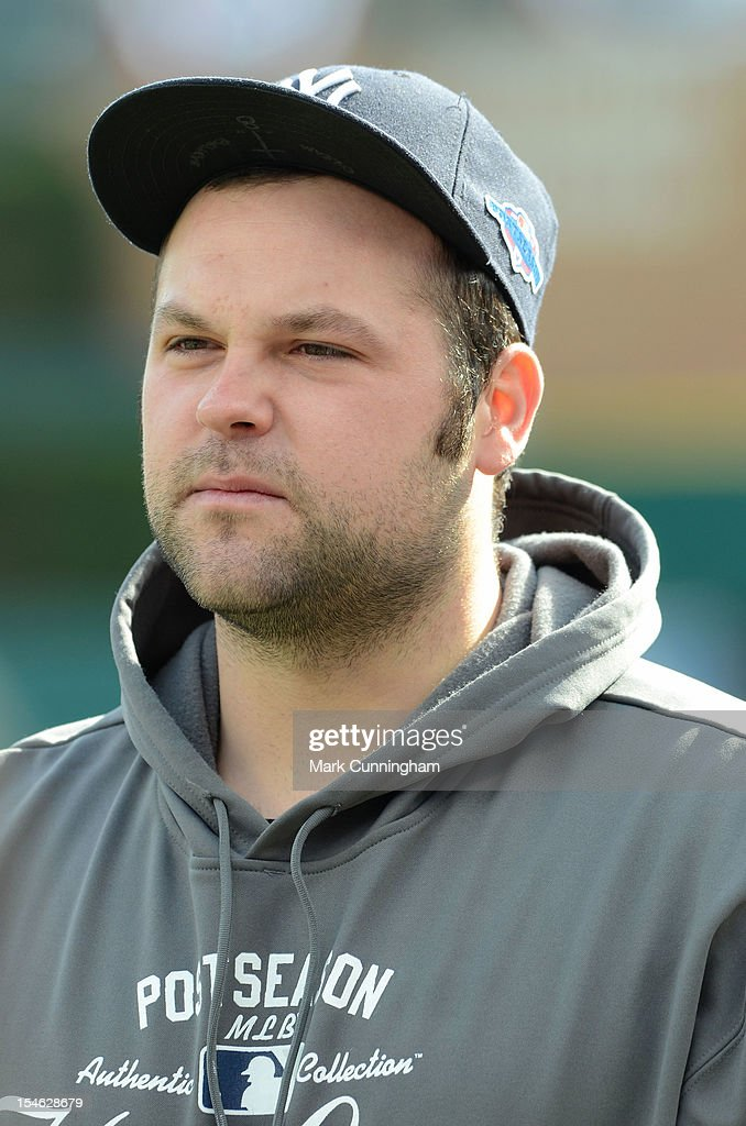 Joba Chamberlain #62 of the New York Yankees looks on prior to Game Four of the American League Championship Series against the Detroit Tigers at Comerica Park on October 18, 2012 in Detroit, Michigan. The Tigers defeated the Yankees 8-1 and now advance to the World Series.
