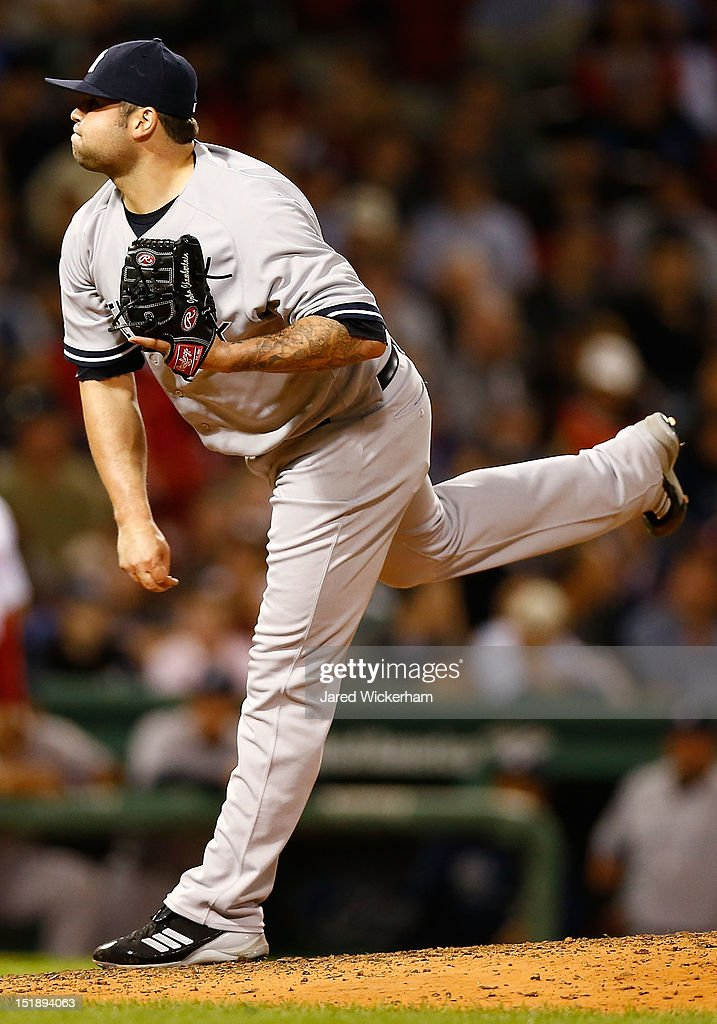 <a gi-track='captionPersonalityLinkClicked' href=/galleries/search?phrase=Joba+Chamberlain&family=editorial&specificpeople=4391682 ng-click='$event.stopPropagation()'>Joba Chamberlain</a> #62 of the New York Yankees pitches against the Boston Red Sox during the game on September 12, 2012 at Fenway Park in Boston, Massachusetts.