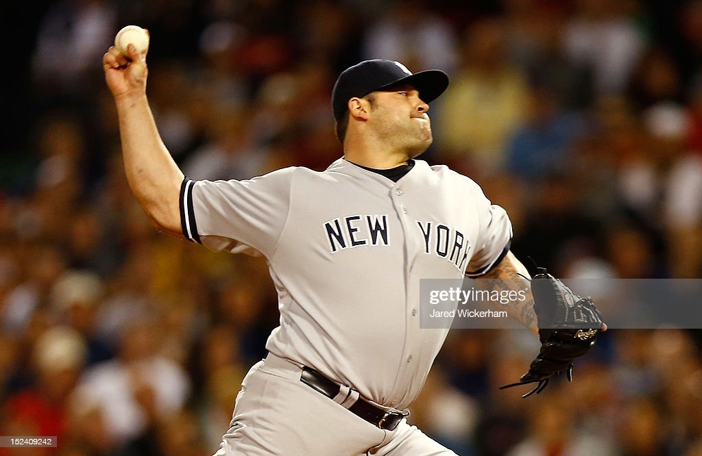 Joba Chamberlain #62 of the New York Yankees pitches against the Boston Red Sox during the game on September 11, 2012 at Fenway Park in Boston, Massachusetts.