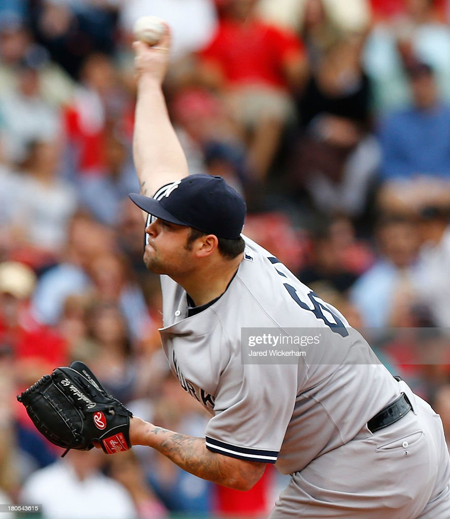 <a gi-track='captionPersonalityLinkClicked' href=/galleries/search?phrase=Joba+Chamberlain&family=editorial&specificpeople=4391682 ng-click='$event.stopPropagation()'>Joba Chamberlain</a> #62 of the New York Yankees pitches against the Boston Red Sox during the game on September 14, 2013 at Fenway Park in Boston, Massachusetts.