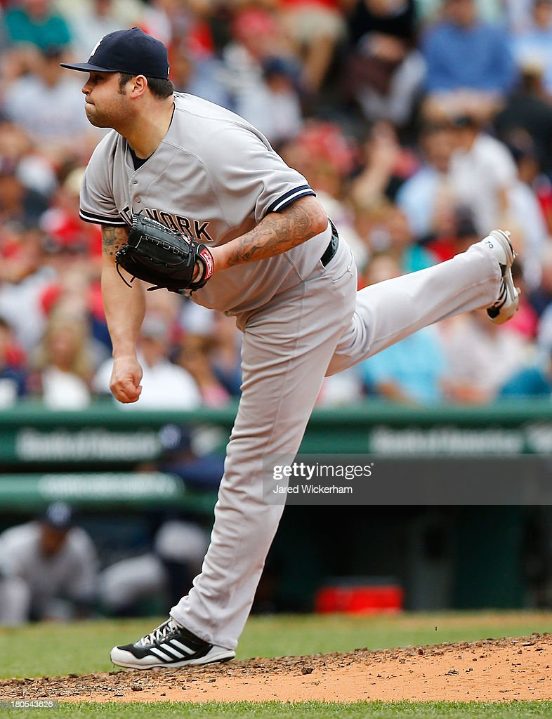 Joba Chamberlain #62 of the New York Yankees pitches against the Boston Red Sox during the game on September 14, 2013 at Fenway Park in Boston, Massachusetts.