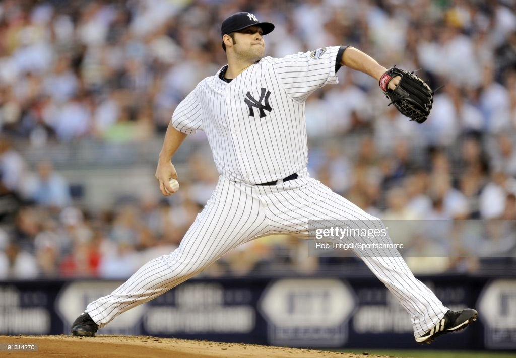 Joba Chamberlain of the New York Yankees pitches against the Boston Red Sox at Yankee Stadium on August 6 2009 in the Bronx borough of New York City...