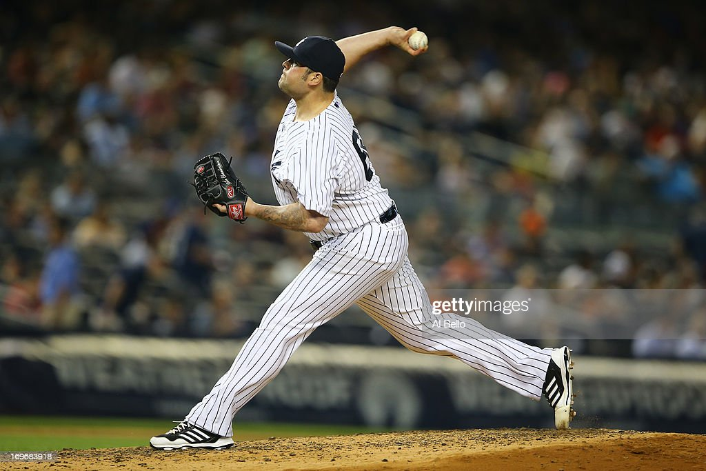 <a gi-track='captionPersonalityLinkClicked' href=/galleries/search?phrase=Joba+Chamberlain&family=editorial&specificpeople=4391682 ng-click='$event.stopPropagation()'>Joba Chamberlain</a> #62 of the New York Yankees pitches against the New York Mets during their game on May 30, 2013 at Yankee Stadium in the Bronx borough of New York City