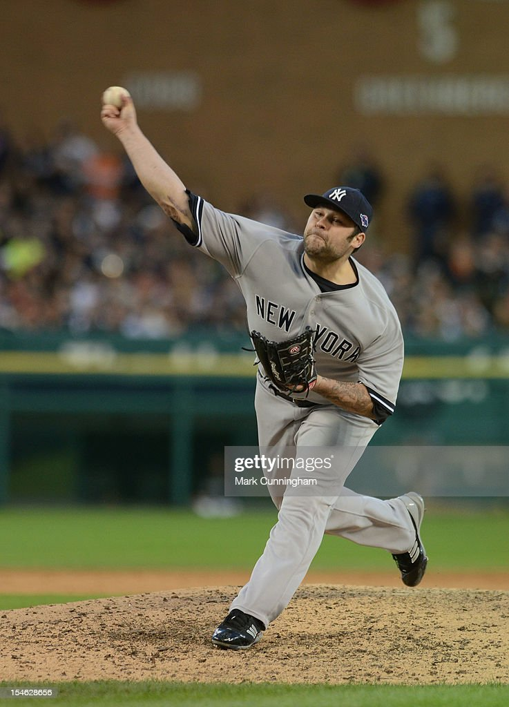 Joba Chamberlain #62 of the New York Yankees pitches during Game Four of the American League Championship Series against the Detroit Tigers at Comerica Park on October 18, 2012 in Detroit, Michigan. The Tigers defeated the Yankees 8-1 and now advance to the World Series.