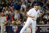Joba Chamberlain of the New York Yankees pumps his fist after striking out Vladimir Guerrero for the third out in the top of the seventh inning...