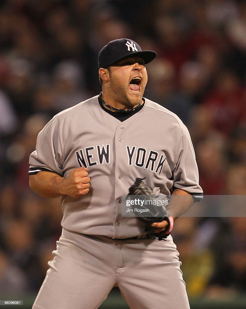 Joba Chamberlain of the New York Yankees reacts after getting out of trouble in the 8th inning against the Boston Red Sox at Fenway Park on April 6...