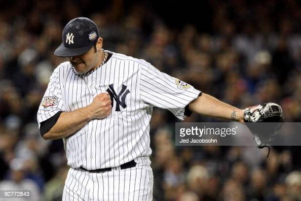 Joba Chamberlain of the New York Yankees reacts after he recorded the final out of the top of the sixth inning against the Philadelphia Phillies in...