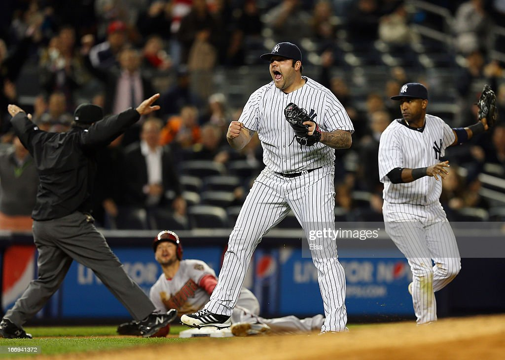 Joba Chamberlain #62 of the New York Yankees reacts after he thinks Cody Ross of the Arizona Diamondbacks is out at third but he is called safe in the eighth inning on April 18, 2013 at Yankee Stadium in the Bronx borough of New York City.The Arizona Diamondbacks defeated the New York Yankees 6-2 in 12 innings.