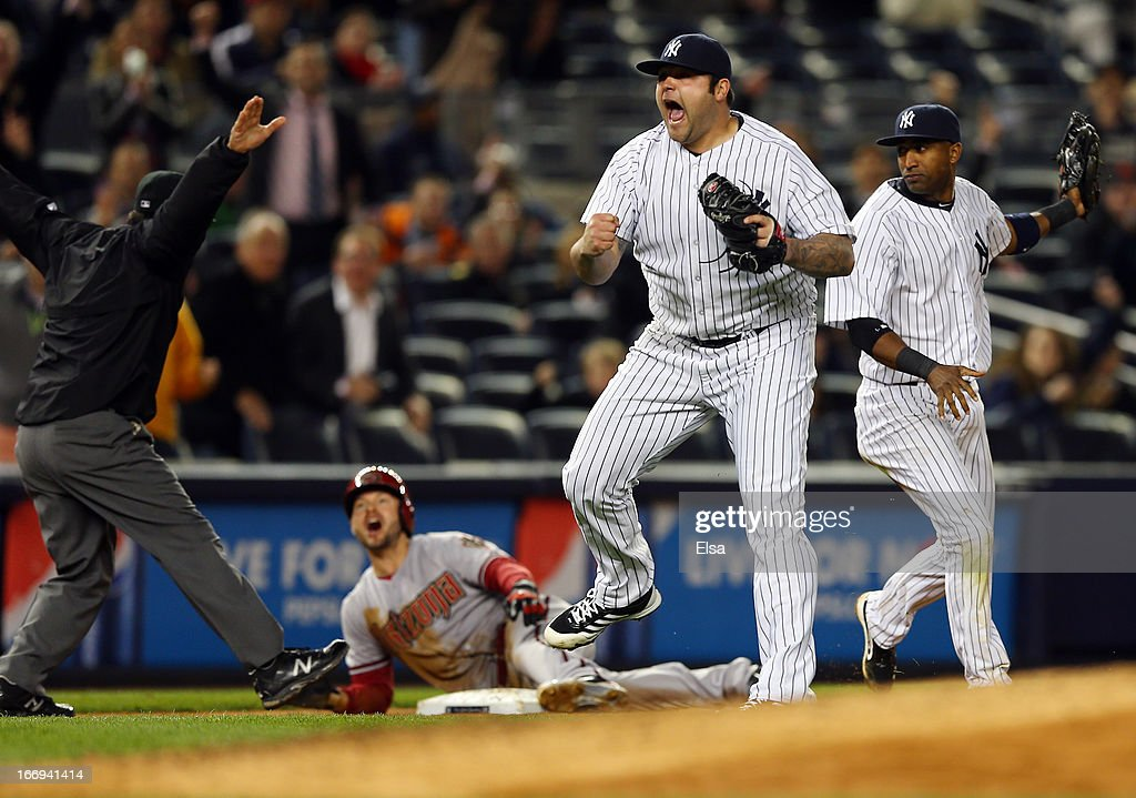 <a gi-track='captionPersonalityLinkClicked' href=/galleries/search?phrase=Joba+Chamberlain&family=editorial&specificpeople=4391682 ng-click='$event.stopPropagation()'>Joba Chamberlain</a> #62 of the New York Yankees reacts after he thinks <a gi-track='captionPersonalityLinkClicked' href=/galleries/search?phrase=Cody+Ross&family=editorial&specificpeople=545810 ng-click='$event.stopPropagation()'>Cody Ross</a> of the Arizona Diamondbacks is out at third but he is called safe in the eighth inning on April 18, 2013 at Yankee Stadium in the Bronx borough of New York City.The Arizona Diamondbacks defeated the New York Yankees 6-2 in 12 innings.