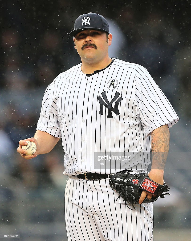 Joba Chamberlain #62 of the New York Yankees reacts after runs are scored in the ninth inning against the Boston Red Sox during Opening Day on April 1, 2013 at Yankee Stadium in the Bronx borough of New York City.