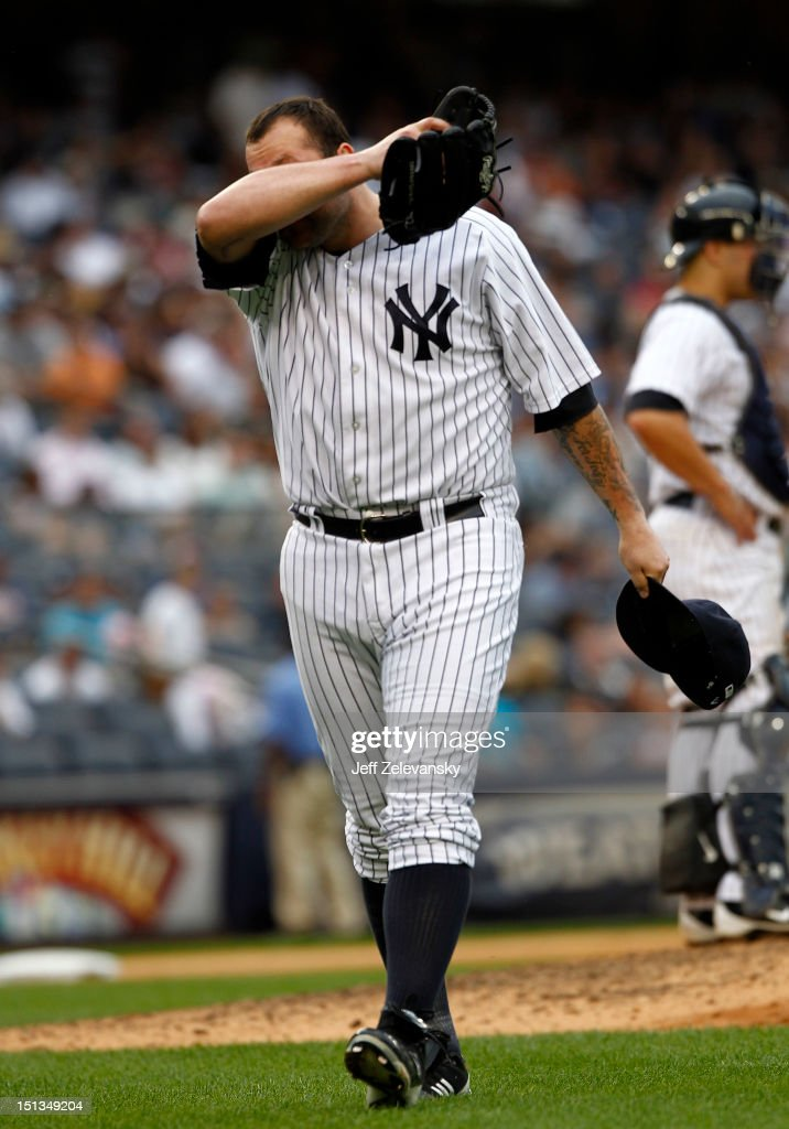 Joba Chamberlain #62 of the New York Yankees reacts against the Baltimore Orioles at Yankee Stadium on September 2, 2012 in the Bronx Borough of New York City.