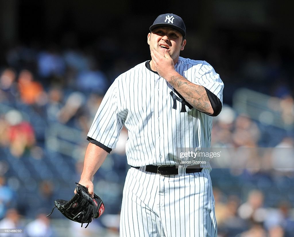 Joba Chamberlain #62 of the New York Yankees reacts as he walks off the pitchers mound against the Toronto Blue Jays in the first game of a doubleheader at Yankee Stadium on September 19, 2012 in the Bronx borough of New York City. (Photo by Jason Szenes/Getty Images