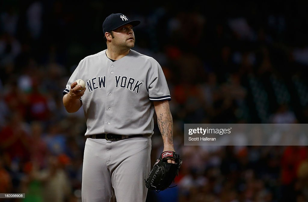 <a gi-track='captionPersonalityLinkClicked' href=/galleries/search?phrase=Joba+Chamberlain&family=editorial&specificpeople=4391682 ng-click='$event.stopPropagation()'>Joba Chamberlain</a> #62 of the New York Yankees reacts to allowing a two run double in the seventh inning against the Houston Astros at Minute Maid Park on September 27, 2013 in Houston, Texas.