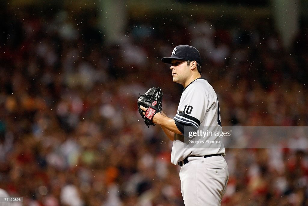 Joba Chamberlain #62 of the New York Yankees readies himself to pitch as gnats swarm around them against the Cleveland Indians during Game Two of the American League Divisional Series at Jacobs Field on October 5, 2007 in Cleveland, Ohio.