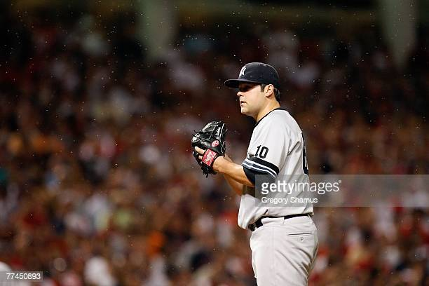 Joba Chamberlain of the New York Yankees readies himself to pitch as gnats swarm around them against the Cleveland Indians during Game Two of the...