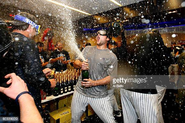 Joba Chamberlain of the New York Yankees sprays champagne while celebrating their 52 victory over the Los Angeles Angels of Anaheim in Game Six of...