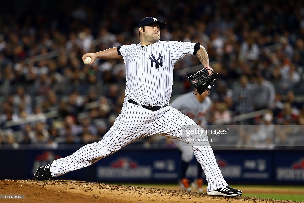 Joba Chamberlain #62 of the New York Yankees throws a pitch against the Detroit Tigers during Game Two of the American League Championship Series at Yankee Stadium on October 14, 2012 in the Bronx borough of New York City.