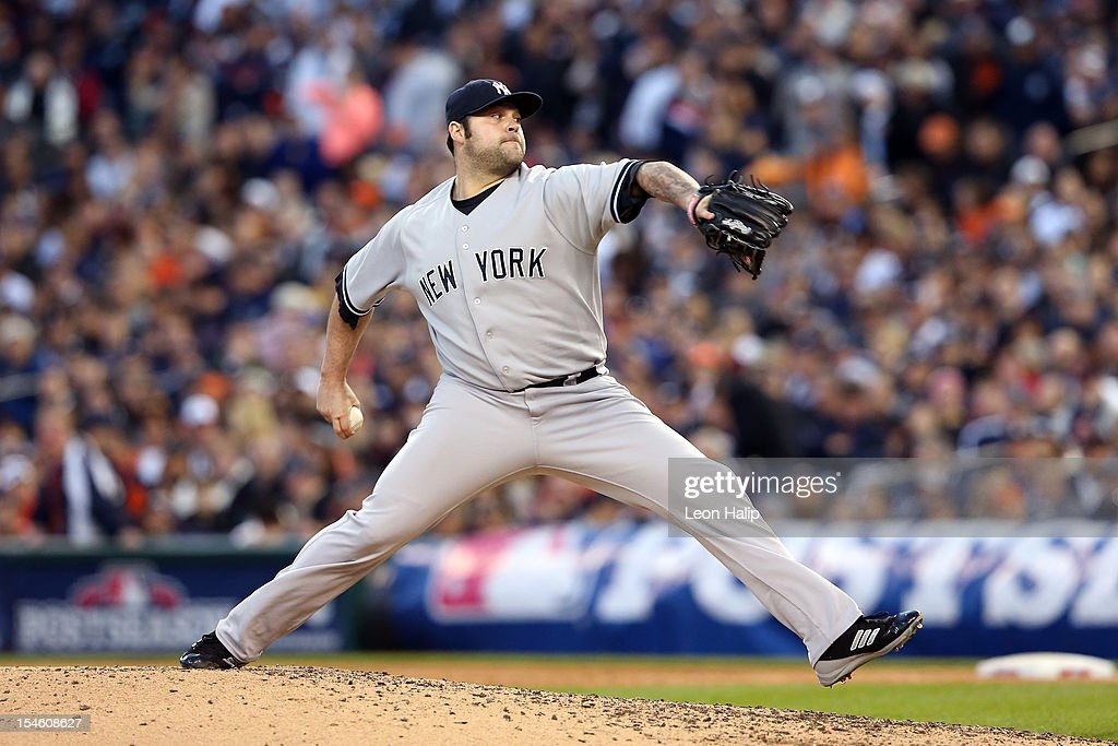 Joba Chamberlain #62 of the New York Yankees throws a pitch against the Detroit Tigers during game four of the American League Championship Series at Comerica Park on October 18, 2012 in Detroit, Michigan. The Tigers won 8-1.