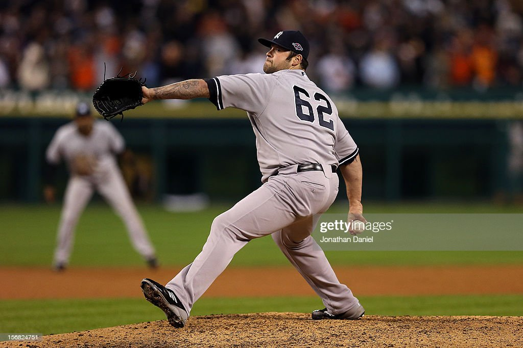 Joba Chamberlain #62 of the New York Yankees throws a pitch against the Detroit Tigers during game three of the American League Championship Series at Comerica Park on October 16, 2012 in Detroit, Michigan.