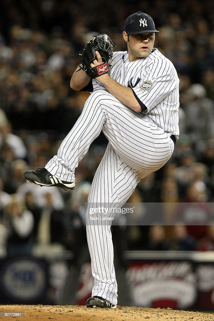 Joba Chamberlain of the New York Yankees throws a pitch against the Philadelphia Phillies in Game Six of the 2009 MLB World Series at Yankee Stadium...