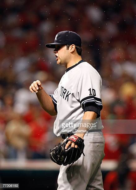 Joba Chamberlain of the New York Yankees waits for the ball to be thrown back to him as a swarm of gnats fly around his head against the Cleveland...