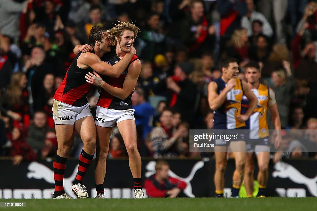<a gi-track='captionPersonalityLinkClicked' href=/galleries/search?phrase=Jobe+Watson&family=editorial&specificpeople=235888 ng-click='$event.stopPropagation()'>Jobe Watson</a> and Dyson Heppell of the Bombers celebrate the winning goal during the round 14 AFL match between the West Coast Eagles and the Essendon Bombers at Patersons Stadium on June 27, 2013 in Perth, Australia.
