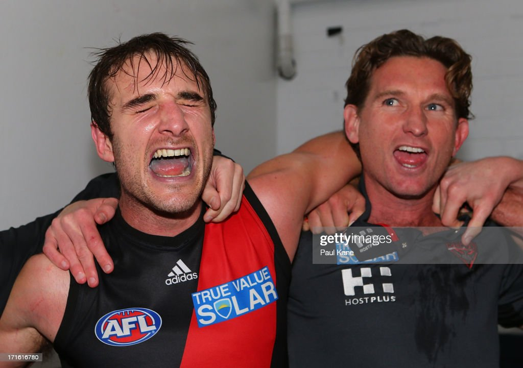 <a gi-track='captionPersonalityLinkClicked' href=/galleries/search?phrase=Jobe+Watson&family=editorial&specificpeople=235888 ng-click='$event.stopPropagation()'>Jobe Watson</a> and <a gi-track='captionPersonalityLinkClicked' href=/galleries/search?phrase=James+Hird&family=editorial&specificpeople=201975 ng-click='$event.stopPropagation()'>James Hird</a> of the Bombers sing the club song after winning the round 14 AFL match between the West Coast Eagles and the Essendon Bombers at Patersons Stadium on June 27, 2013 in Perth, Australia.