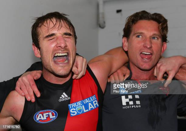 Jobe Watson and James Hird of the Bombers sing the club song after winning the round 14 AFL match between the West Coast Eagles and the Essendon...