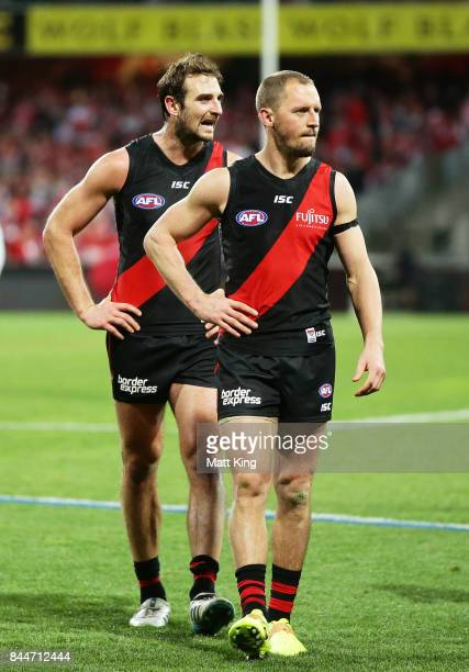 Jobe Watson and James Kelly of the Bombers looks dejected as they leave the field after playing their last AFL match during the AFL Second...