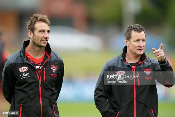 Jobe Watson and John Worsfold Senior Coach of the Bombers look on during an Essendon Bombers AFL preseason training session at True Value Solar...