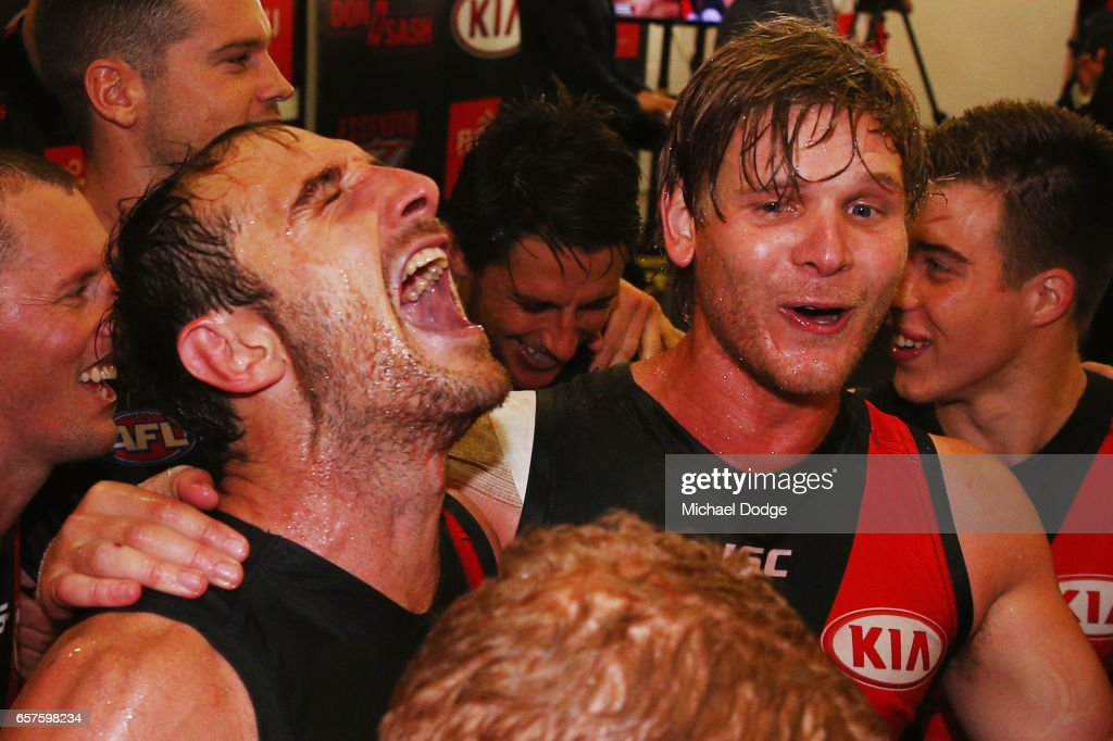 , Jobe Watson and Michael Hurley of the Bombers sing the club song after winning during the round one AFL match between the Essendon Bombers and the Hawthorn Hawks at Melbourne Cricket Ground on March 25, 2017 in Melbourne, Australia.